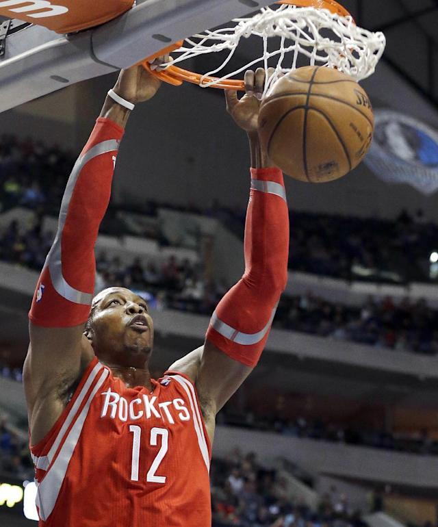 Houston Rockets center Dwight Howard slam dunks during the first half of an NBA basketball game against the Dallas Mavericks, Wednesday, Jan. 29, 2014, in Dallas. (AP Photo/LM Otero)