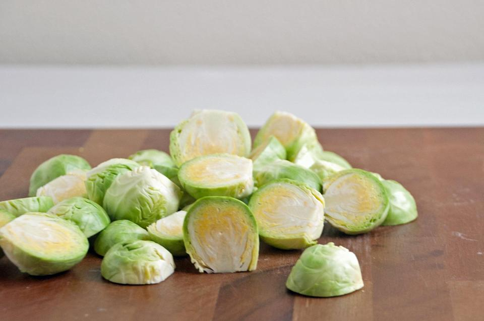 <p>Slice the sprouts in half from top to bottom.</p>