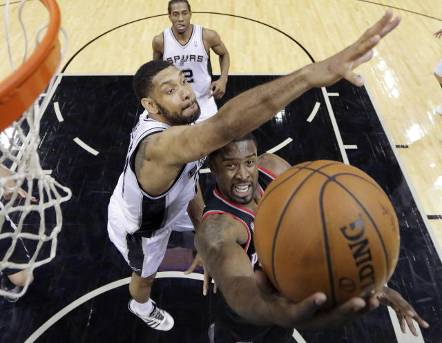 Portland Trail Blazers' Wesley Matthews, right, shoots around San Antonio Spurs' Tim Duncan, left, during the first half of Game 1 of a Western Conference semifinal NBA basketball playoff series, Tuesday, May 6, 2014, in San Antonio. (AP Photo/Eric Gay)