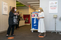 First lady Jill Biden, right, speaks with Kim Thiboldeaux, left, CEO of the Cancer Support Community, during a tour of Whitman-Walker Health, Friday, Jan. 22, 2021, in Washington. (AP Photo/Jacquelyn Martin, Pool)