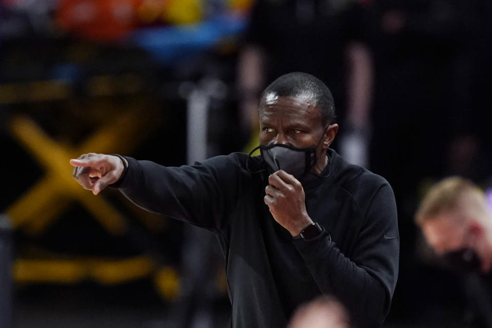 Detroit Pistons head coach Dwane Casey directs from the sideline during the first half of an NBA basketball game against the Chicago Bulls, Sunday, May 9, 2021, in Detroit. (AP Photo/Carlos Osorio)