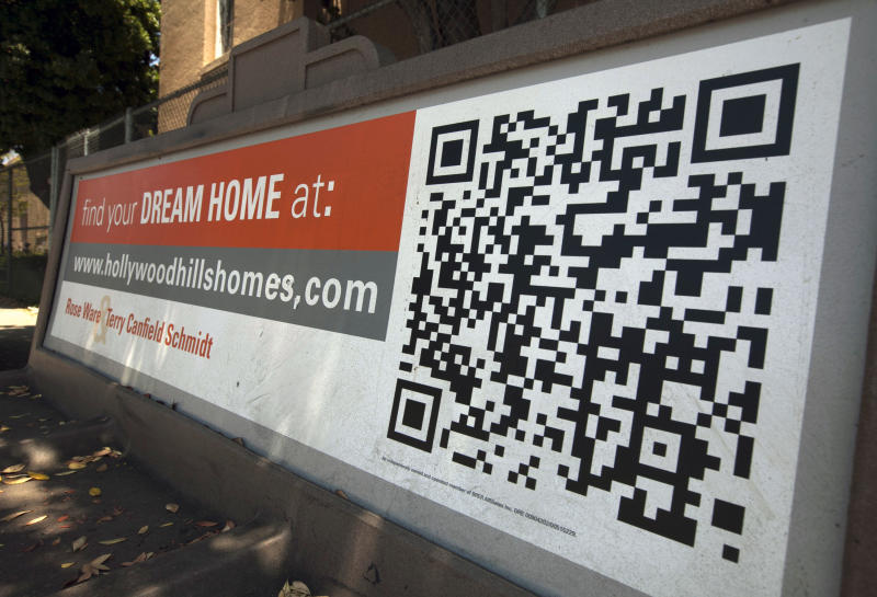 "In this Tuesday, July 17, 2012 photo, a Quick Response Code is used on Realtor ad offering ""dream homes"" in the Hollywood Hills area of Los Angeles. Americans bought more homes in July than in June and prices rose, the latest evidence that the housing market is slowly recovering. Sales of previously occupied homes rose to 4.47 million in July, a 2.3 percent increase from the previous month, the National Association of Realtors said Wednesday. (AP Photo/Damian Dovarganes)"