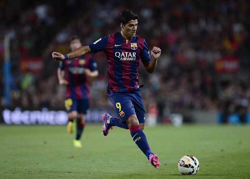Barcelona's Uruguayan forward Luis Suarez plays during the 49th Joan Gamper Trophy match against Leon Club at the Camp Nou stadium in Barcelona on August 18, 2014