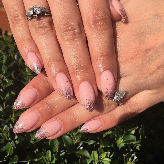 """<p>This ombre nude and silver glitter makes the perfect wedding manicure.</p><p><a href=""""https://www.instagram.com/p/Bvl-_KRAvlC/"""" rel=""""nofollow noopener"""" target=""""_blank"""" data-ylk=""""slk:See the original post on Instagram"""" class=""""link rapid-noclick-resp"""">See the original post on Instagram</a></p>"""