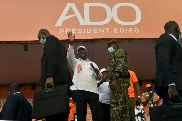 Opponents say Ivory Coast incumbent president Alassane Ouattara's (C) bid for a third term is illegal