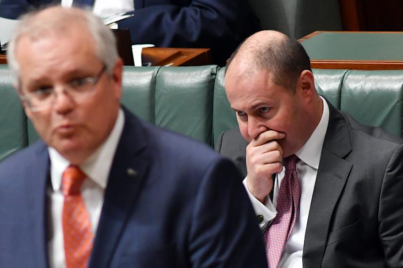 CANBERRA, AUSTRALIA - JUNE 11: Treasurer Josh Frydenberg reacts as Prime Minister Scott Morrison speaks at the despatch box during Question Time in the House of Representatives at Parliament House on June 11, 2020 in Canberra, Australia. An OECD report forecasted that the global economy will contract 6% in 2020, and 7.6% if there is a second wave of Covid-19 infections and that the pandemic has triggered the most severe peace-time recession in nearly a century. (Photo by Sam Mooy/Getty Images)
