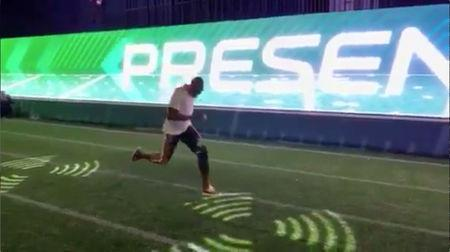 Olympic sprint champion Usain Bolt of Jamaica runs during a Super Bowl fan experience event on February 2, 2019, in Atlanta, Georgia, U.S. in this still frame obtained from social media video. ZACK COX/Social Media via REUTERS