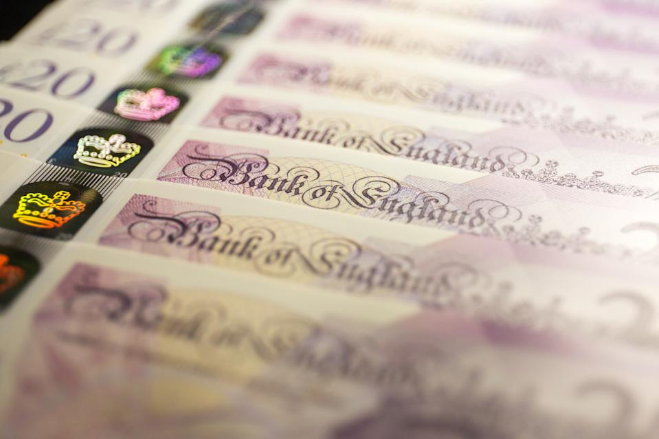 UNITED KINGDOM - 2020/06/06: In this photo illustration banknotes of the pound sterling, The Bank of England £20 notes are seen displayed. (Photo Illustration by Karol Serewis/SOPA Images/LightRocket via Getty Images)