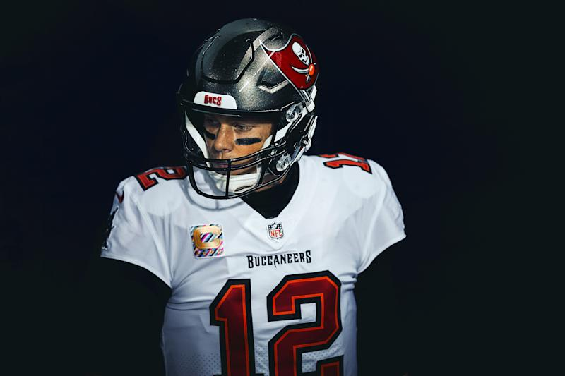 Tom Brady stares to the side in a Buccaneers uniform.