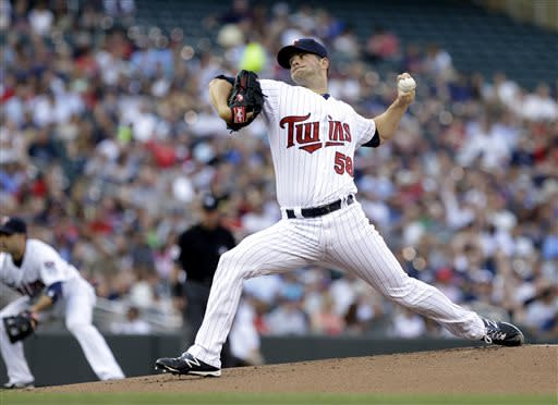 Minnesota Twins pitcher Scott Diamond throws against the New York Yankees in the first inning of a baseball game, Monday, July 1, 2013, in Minneapolis. (AP Photo/Jim Mone)