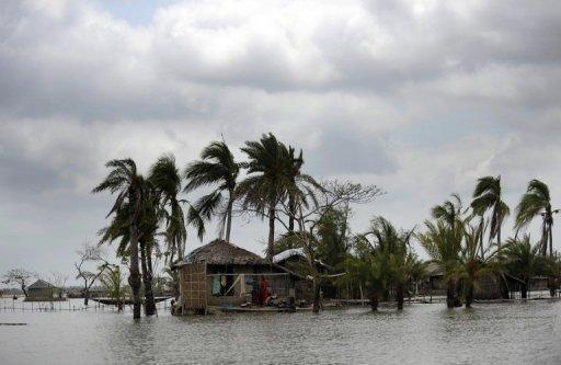 File photo of flooded Bangladeshi houses in Gabura after a cyclone slammed into the area. The terrible human cost of cyclones and flooding are plain to see in southwest Bangladesh, a low-lying, impoverished region on the frontline of the battle to adapt to climate change. Sea levels are rising 60-percent faster than the UN's climate panel forecast in its most recent assessment, scientists say