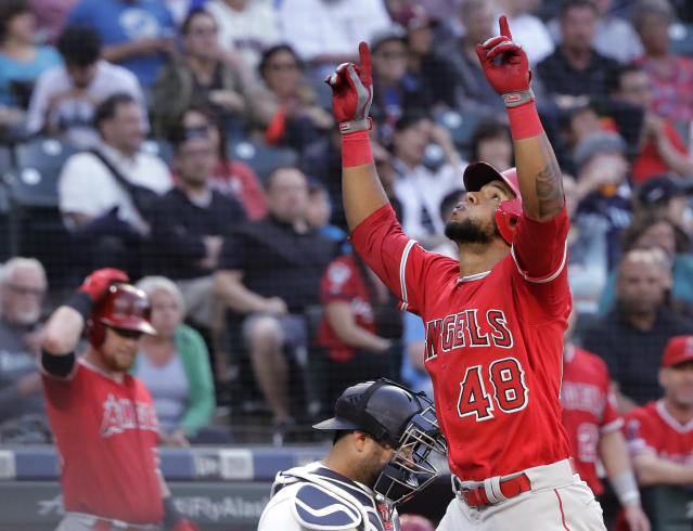 Los Angeles Angels' Cesar Puello (48) reacts as he crosses the plate after hitting a solo home run during the third inning of the team's baseball game against the Seattle Mariners, Thursday, May 30, 2019, in Seattle. (AP Photo/Ted S. Warren)