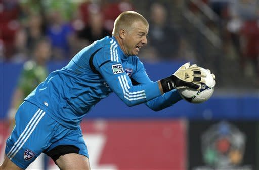 FC Dallas goalkeeper Kevin Hartman makes a save against the Seattle Sounders in the first half of an MLS soccer game, Wednesday, May 9, 2012, in Frisco, Texas. (AP Photo/Tony Gutierrez