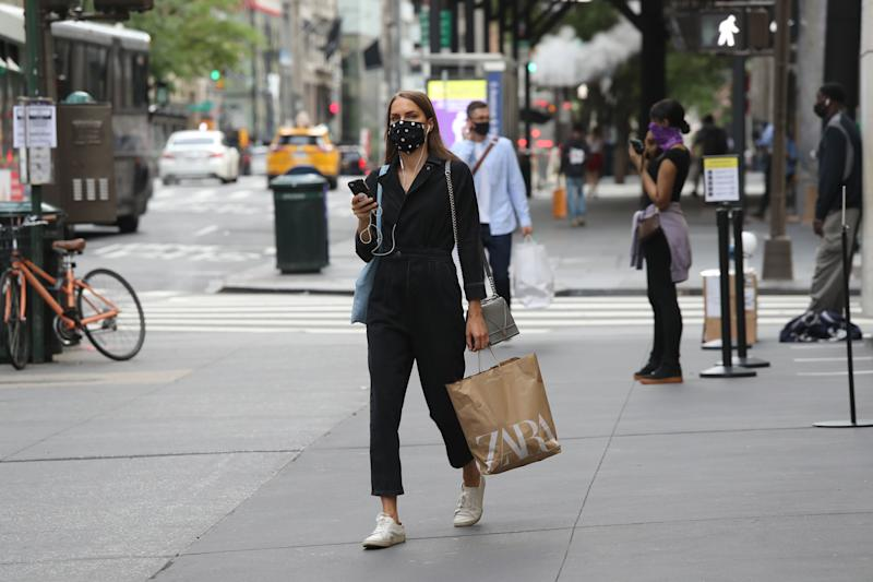 NEW YORK, NEW YORK - JULY 01: A person walks with a Zara shopping bag as New York City moves into Phase 2 of re-opening following restrictions imposed to curb the coronavirus pandemic on July 1, 2020 in New York, New York. Phase 2 permits the re-opening of office jobs, real estate services, in-store retail services such as rentals, repairs and hair salons, and outdoor dining. (Photo by Rob Kim/Getty Images)