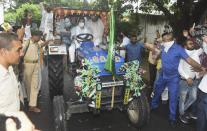 RJD leader Tejashwi Yadav rides a tractor along with party supporters during 'Bharat Bandh', a protest against the farm bills passed in Parliament recently, in Patna, Friday, Sept. 25, 2020. (PTI Photo)