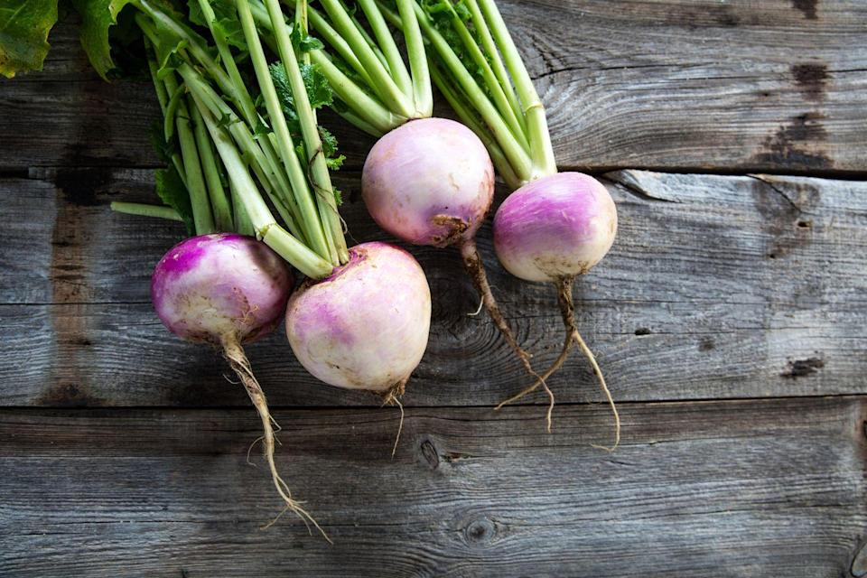 """<p>This root vegetable is rich in fiber and micronutrients including calcium, phosphorus, and <a href=""""https://www.goodhousekeeping.com/health/diet-nutrition/g2065/potassium-superfoods/"""" rel=""""nofollow noopener"""" target=""""_blank"""" data-ylk=""""slk:potassium"""" class=""""link rapid-noclick-resp"""">potassium</a>. Not only are turnips relatively inexpensive, but their neutral taste makes them easy to add to a big variety of recipes. </p>"""