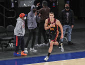 Atlanta Hawks guard Bogdan Bogdanovic (13) celebrates after making a 3-point basket against the New York Knicks to tie the score in the fourth quarter of an NBA basketball game Wednesday, April 21, 2021, in New York. (Wendell Cruz/Pool Photo via AP)