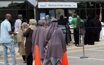 Minneapolis voters line up to vote a day ahead of Minnesota's Tuesday primary election on Monday, Aug. 10, 2020, at the Minneapolis Election and Voters Services offices. (AP Photo/Jim Mone)