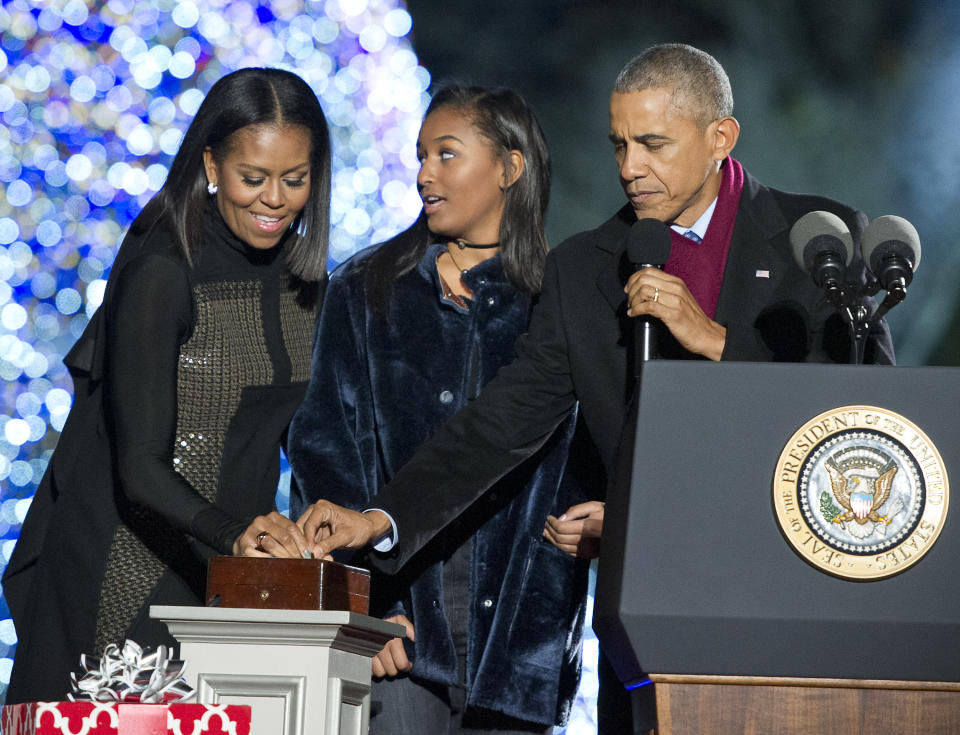 WASHINGTON, DC - DECEMBER 1:  U.S. President Barack Obama, first lady Michelle Obama and Sasha Obama trip the switch at the National Christmas Tree Lighting on the Ellipse December 1, 2016 in Washington, DC. This year is the 94th annual National Christmas Tree Lighting Ceremony.   (Photo by Ron Sachs-Pool/Getty Images)