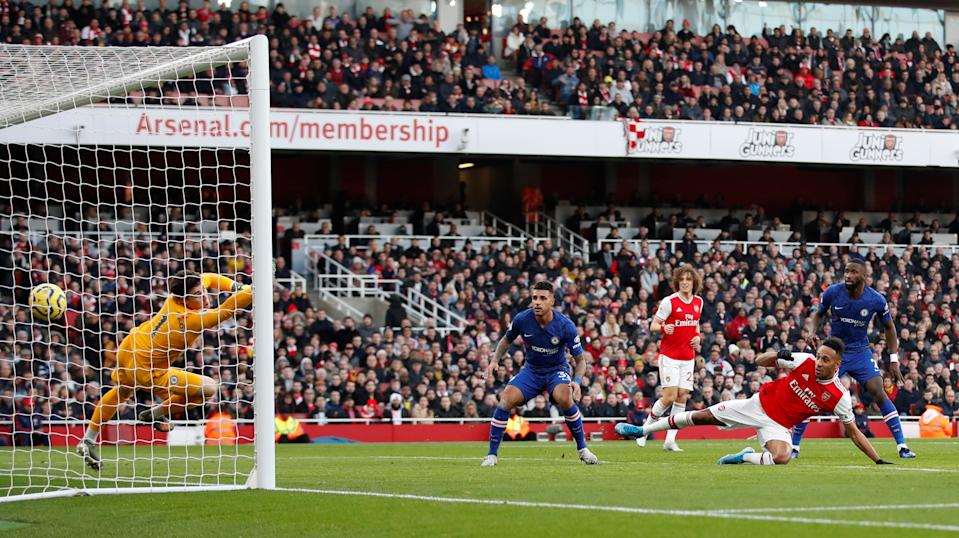 """Soccer Football - Premier League - Arsenal v Chelsea - Emirates Stadium, London, Britain - December 29, 2019 Arsenal's Pierre-Emerick Aubameyang scores their first goal  Action Images via Reuters/Matthew Childs  EDITORIAL USE ONLY. No use with unauthorized audio, video, data, fixture lists, club/league logos or """"live"""" services. Online in-match use limited to 75 images, no video emulation. No use in betting, games or single club/league/player publications.  Please contact your account representative for further details."""