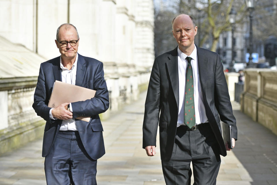 England's Chief Medical Officer Chris Whitty, right, and Chief Scientific Adviser Patrick Vallance in London, Monday March 16, 2020, ahead of a meeting with the Government's emergency committee to discuss coronavirus. For most people, the new coronavirus causes only mild or moderate symptoms. For some, it can cause more severe illness, especially in older adults and people with existing health problems. (Dominic Lipinski/PA via AP)