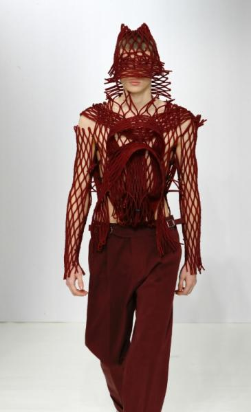 Planet Fashion calling Earth: Designer Craig Brown wove rubber mesh around his models like that used to wrap fruit