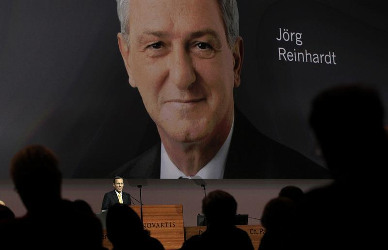 Designated successor Reinhardt is seen on a huge TV screen as outgoing utgoing Chairman of Swiss drug maker Novartis Vasella addresses the the annual shareholders general meeting in Basel