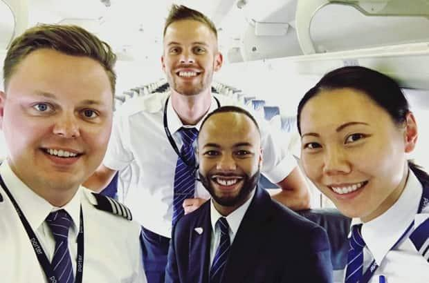 Ryan Sullivan, left, seen here with members of his flight crew, was working as a pilot for Porter Airlines when the pandemic hit. When the airline grounded its fleet, he retrained as a certified sommelier. (Ryan Sullivan - image credit)