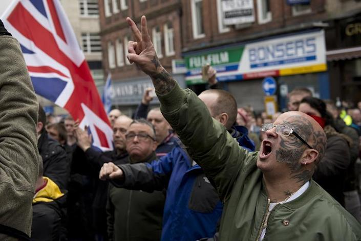 Protesters chant during a demonstration by the UK branch of the Germany-based 'anti-Islamisation' PEGIDA group in the centre of Newcastle, northeast England on February 28, 2015 (AFP Photo/Oli Scarff)