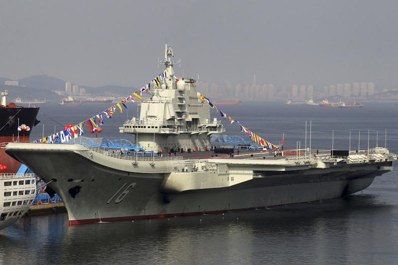 China's as yet unnamed aircraft carrier is decorated with coloured flags at a shipyard in Dalian in northeast China's Liaoning province Monday Sept. 24, 2012. The carrier, built on former Ukrainian vessel Varyag, was delivered to the Chinese navy Sunday Sept 23, 2012 according to state media. (AP Photo) CHINA OUT