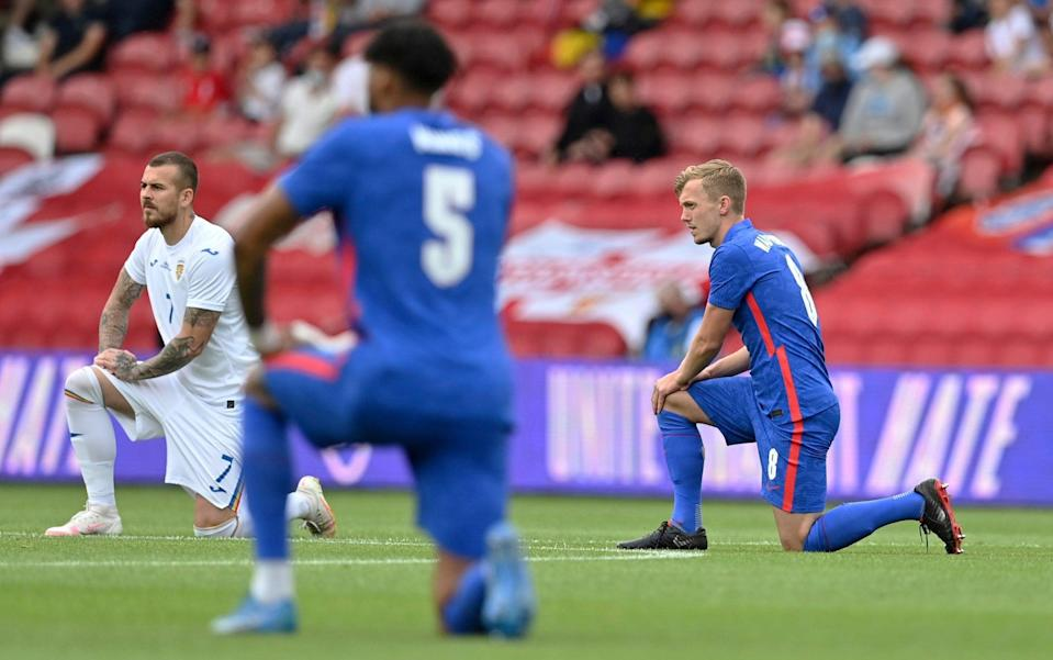 England players take the knee ahead of their Euro 2020 warm-up friendly against Romania - AP