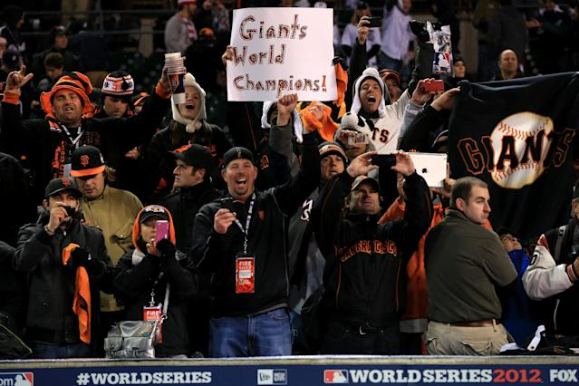 "DETROIT, MI - OCTOBER 28: The San Francisco Giants fans hold up a sign that reads, ""Giants World Champions!"" after defeating the Detroit Tigers in the tenth inning to win Game Four of the Major League Baseball World Series at Comerica Park on October 28, 2012 in Detroit, Michigan. The San Francisco Giants defeated the Detroit Tigers 4-3 in the tenth inning to win the World Series in 4 straight games. (Photo by Doug Pensinger/Getty Images)"