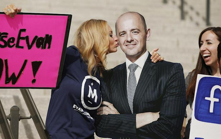 Brynnley Pyne shows her support for a cardboard cutout of her candidate at an Evan McMullin rally in Salt Lake City. (Photo: Jeffrey D. Allred/The Deseret News via AP)