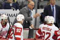 Detroit Red Wings head coach Jeff Blashill, center, gives instructions during the first period of a preseason NHL hockey game against the Pittsburgh Penguins in Pittsburgh, Sunday, Oct. 3, 2021. (AP Photo/Gene J. Puskar)