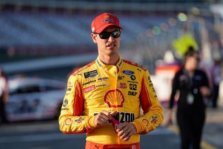 May 23, 2019; Concord, NC, USA; Monster Energy NASCAR Cup Series driver Joey Logano (22) walks to his carduring qualifying for the Coca-Cola 600 at Charlotte Motor Speedway. Mandatory Credit: Jim Dedmon-USA TODAY Sports