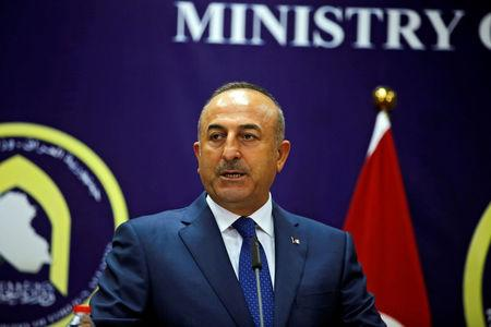 Turkish foreign minister Mevlut Cavusoglu speaks during a joint news conference with Iraqi Foreign Minister Ibrahim al-Jaafari in Baghdad