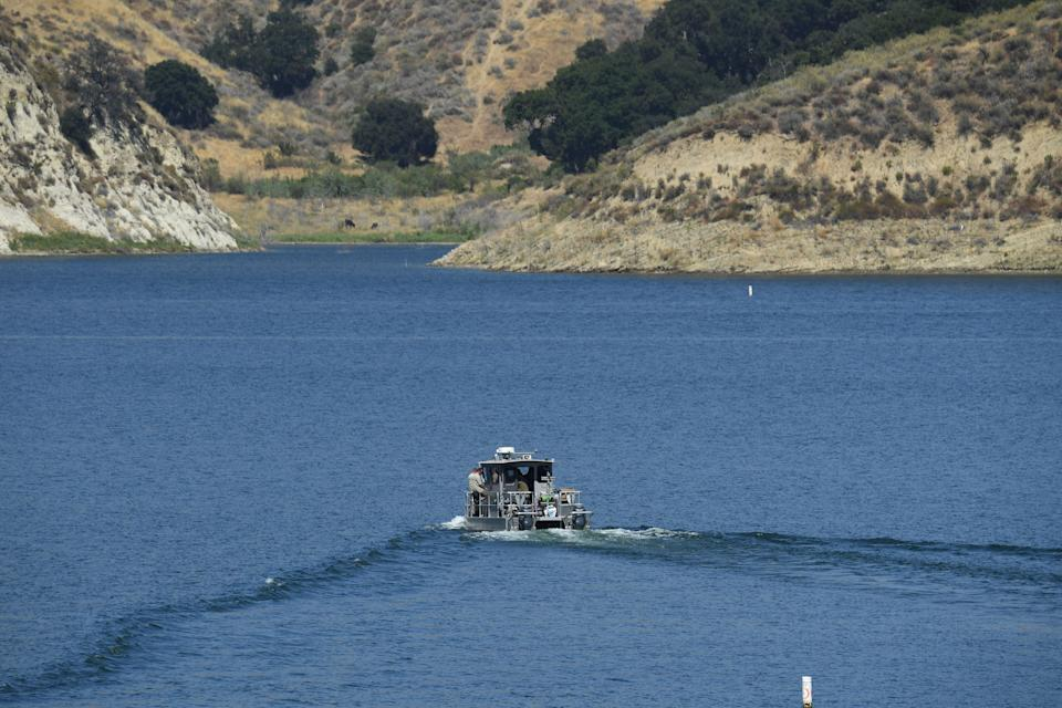 A Los Angeles County Sheriff's Department boat on Lake Piru conducting a search for Rivera on Friday. (AFP via Getty Images)
