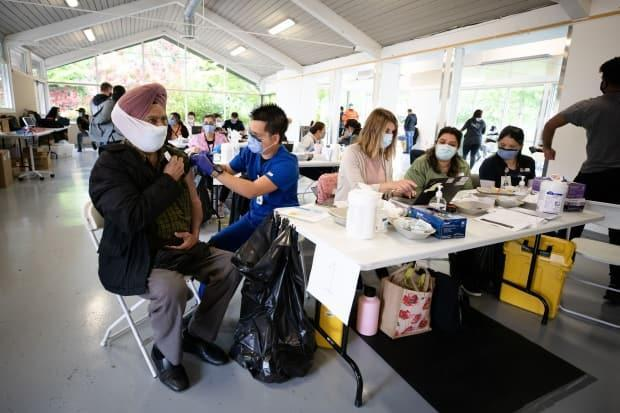 The Pfizer vaccine is administered at Bear Creek Park in Surrey, B.C., on Monday, May 17, 2021. (Maggie MacPherson/CBC) (Maggie MacPherson/CBC - image credit)
