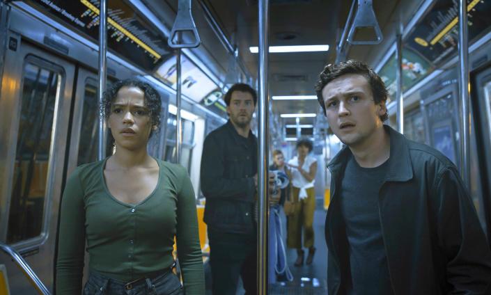 """This image released by Sony Pictures shows Taylor Russell, from left, Thomas Cocquerel and Logan Miller in a scene from """"Escape Room: Tournament of Champions."""" (Sony Pictures via AP)"""