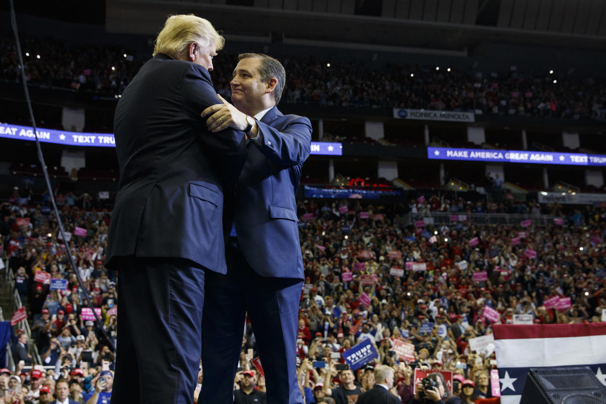 President Trump is greeted by Sen. Ted Cruz as he arrives for a campaign rally at the Houston Toyota Center. (Photo: Evan Vucci/AP)