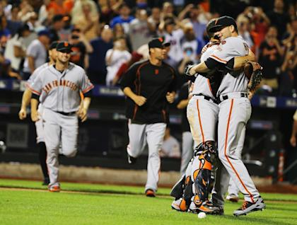 Chris Heston, right, celebrates his no-hitter with Buster Posey on Tuesday night. (Getty)