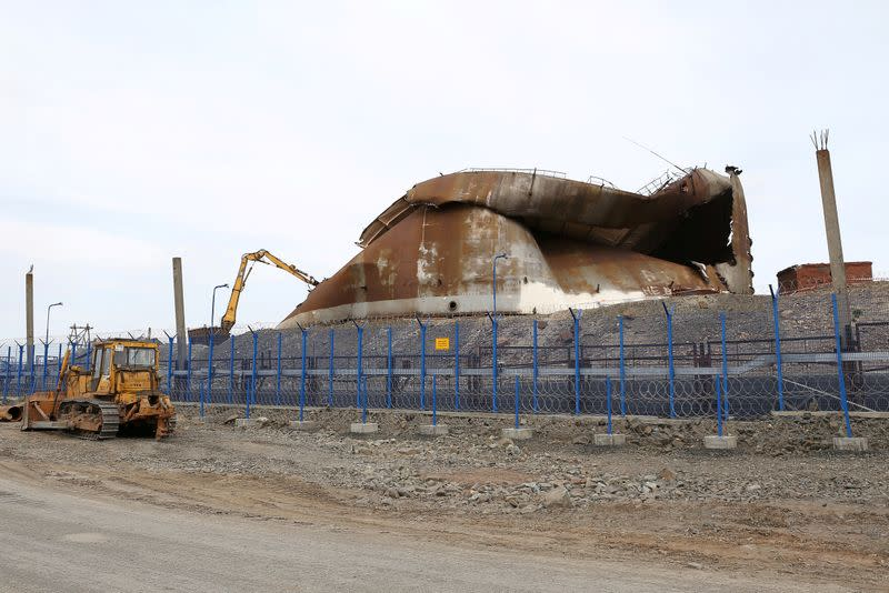 FILE PHOTO: A view shows the TPP-3 power plant during works for the demolition of the fuel tank which collapsed on May 29, resulting in a spill of diesel fuel, in Norilsk