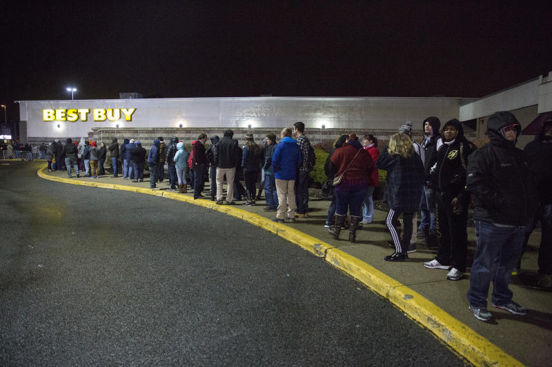 SOUTH PORTLAND, ME - NOVEMBER 24: The line outside of Best Buy wraps all the way around the building at the Maine Mall just before midnight on Thanksgiving. (Photo by Brianna Soukup/Portland Portland Press Herald via Getty Images)