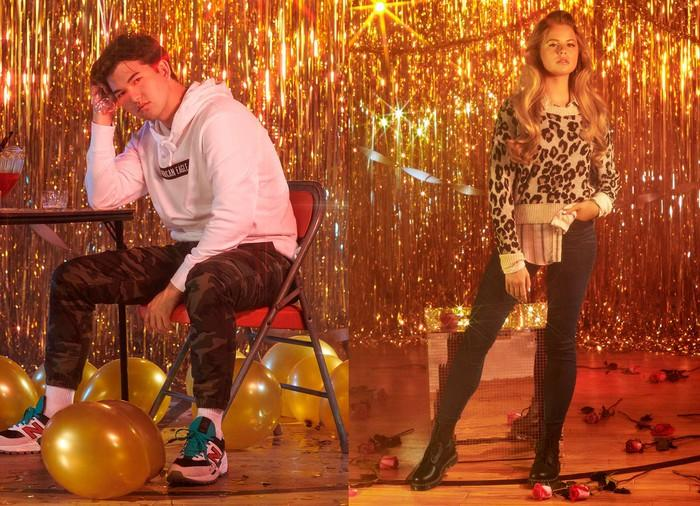 An American Eagle ad: A man and woman modeling clothes against a sparkly backdrop.