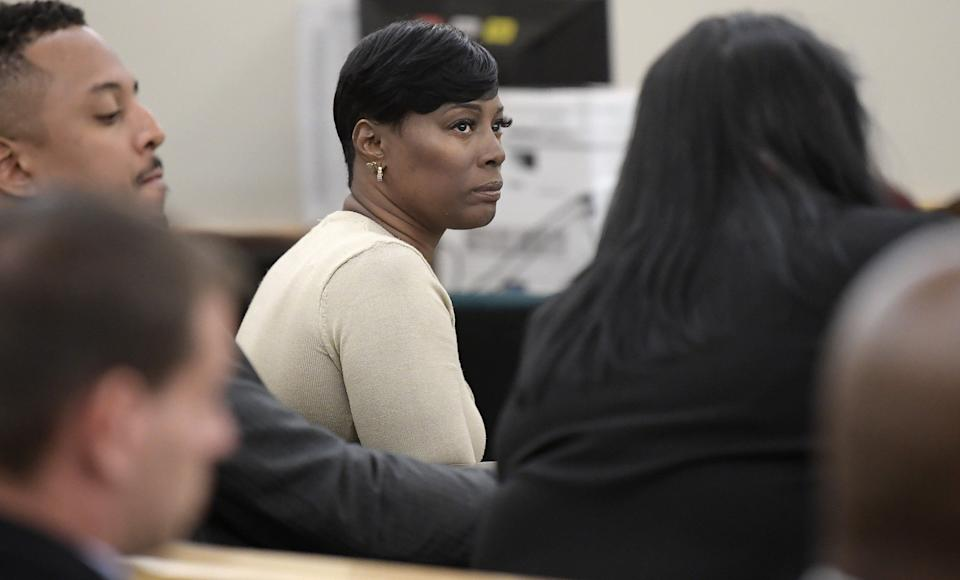Crystal Mason (middle) was convicted for illegal voting and sentenced to five years in prison in 2018. (Photo: Max Faulkner/Fort Worth Star-Telegram/Tribune News Service via Getty Images)
