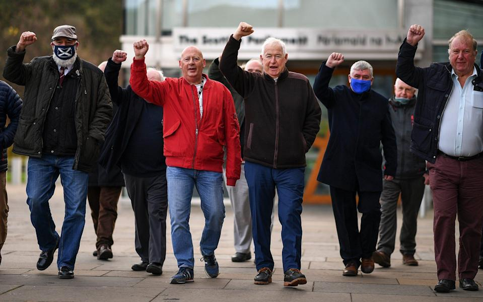 Former miners meet outside the Scottish Parliament on October 28, 2020 in Edinburgh, Scotland - Getty Images Europe