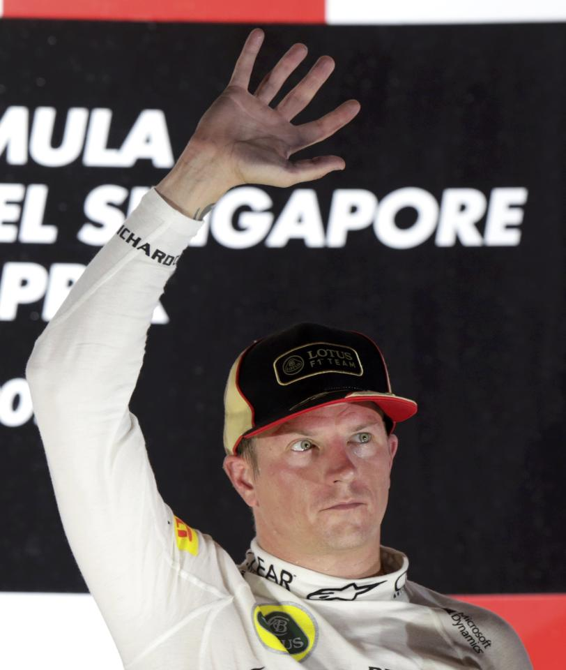 Lotus F1 Formula One driver Kimi Raikkonen of Finland waves after the Singapore F1 Grand Prix at the Marina Bay street circuit in Singapore September 22, 2013. REUTERS/Pablo Sanchez (SINGAPORE - Tags: SPORT MOTORSPORT F1)