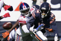 New York Giants cornerback James Bradberry (24) defends Chicago Bears wide receiver Allen Robinson (12) during the first half of an NFL football game in Chicago, Sunday, Sept. 20, 2020. (AP Photo/Charles Rex Arbogast)
