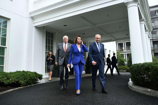 PHOTO: Speaker of the House Nancy Pelosi (C), Senate Minority Leader Chuck Schumer (D-NY) (R) and Representative Steny Hoyer, walk out of the White House after meeting with US President Donald Trump on Oct. 16, 2019. (Brendan Smialowski/AFP via Getty Images, FILE)
