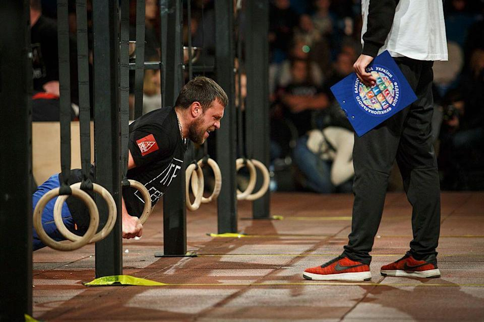 """<p>Once at the CrossFit Games, competitors are <a href=""""https://games.crossfit.com/about-the-games"""" rel=""""nofollow noopener"""" target=""""_blank"""" data-ylk=""""slk:judged with a scoring table"""" class=""""link rapid-noclick-resp"""">judged with a scoring table</a>. Athletes can earn up to 100 points per event and the competitor with the most points at the end wins.</p>"""